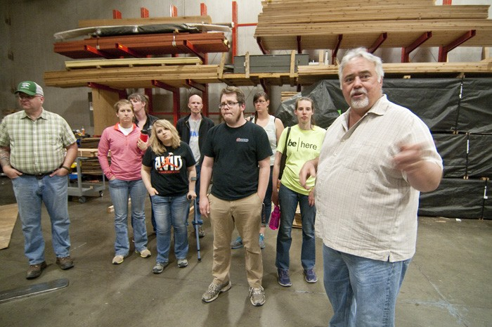 Steve Pozo, right, sales manager at Lakeside Lumber, leads a group of high school teachers on a tour of the siding supplier's Tualatin warehouse. The tour was part of a two-week summer externship designed to familiarize the educators with job opportunities in the building industry. (Sam Tenney/DJC)